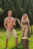 Bavarian couple in the work of firewood