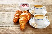 foto of croissant  - fresh Breakfast with croissants espresso and jam on a dark wood background - JPG