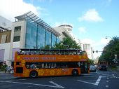 Tourist Double Deckered Waikiki Trolley Turns In Intersection On World Famous Kalakaua Street