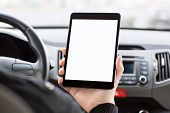 Man Sitting In The Car And Holding A Tablet With Isolated Screen