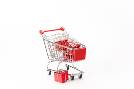 stock photo of caddy  - Caddy for shopping with gift on white background - JPG