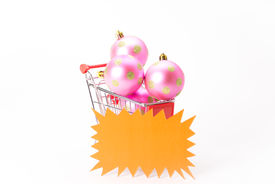 image of caddy  - Caddy for shopping with christmas ball on white background - JPG