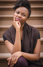 pic of brownstone  - Young black lady sitting on brownstone step thinking - JPG