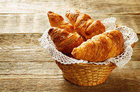 image of continental food  - croissants on a dark wood background - JPG