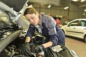 picture of auto repair shop  - Technician woman working in auto repair workshop - JPG