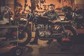 pic of rockabilly  - Mechanic building vintage style cafe - JPG