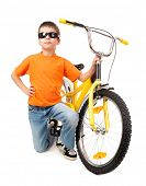 boy in sunglasses on bicycle