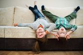 picture of upside  - boy and girl fool upside down at home - JPG
