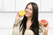 Smiling girl with grapefruit