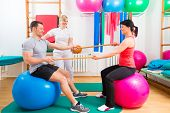 image of physical therapist  - Patients at the physiotherapy doing physical exercises with therapist - JPG