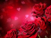 Roses and Hearts background. Valentine or Wedding Card design. Beautiful red roses bouquet over red blurred background. Flowers background. St. Valentine's Day