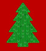 The Christmas Tree Knitted On The Red