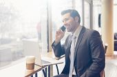 stock photo of tied hair  - Businessman having a coffee break at the coffee shop - JPG