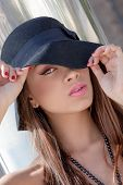 beautiful fashion woman with hat make up and flawless skin