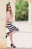 pregnancy fashion, young pregant woman. shoeing tummy