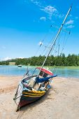 Old Fishing Boat On Tropical Beach At Seychelles