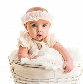 cute little girl in a wicker basket with lace headband