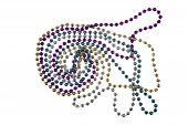 foto of debauchery  - Shiny gold purple blue and silver Mardi Gras beads on white background - JPG