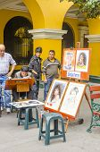 LIMA, PERU, MAY 23, 2014: artist painting caricatures in the street of Lima