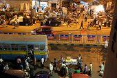 KOLKATA, INDIA - FEB 10: Dark city traffic blurred in motion at late evening on crowded streets on February 10, 2014 in Kolkata. Kolkata has a density of 814.80 vehicles per km road length