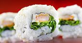 stock photo of rocket salad  - A close up shot of sushi dish uramaki with rocket salad - JPG