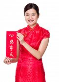 Chinese woman hold with Fai Chun, fai chun, calligraphy, character, handwriting, paper, china, bless, luck, dreams, come, true, wish