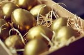 Golden Easter eggs in box or container