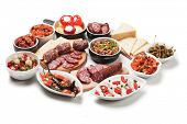 Spanish tapas or antipasto food, cold buffet appetizers isolated on white background