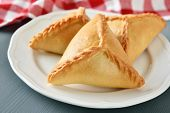stock photo of tatar  - Three echpochmaks the traditional Tatar pastry on a plate  - JPG
