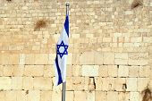 picture of israel people  - The Israeli National Flag against the Kotel Wailing Western Wall empty at night in Jerusalem Israel - JPG