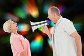 Man shouting at his partner through megaphone against blurred lights