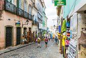 BAHIA, BRAZIL - CIRCA NOV 2014: People walk in Pelourinho area, famous Historic Centre of Salvador, Bahia in Brazil.