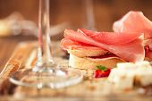 picture of antipasto  - Cured Meat and ciabatta bread on wooden board - JPG