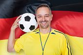 Portrait Of A Happy Man Holding A Soccer Ball