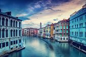 Beautiful Venice city in overcast weather, wonderful water channel between gorgeous colorful medieval buildings, travel to Italy