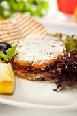 Salmon Tartare with Crispy Bread, Lemon and Salad Leaves