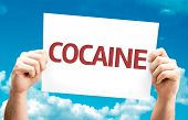 image of crack cocaine  - Cocaine card with sky background - JPG