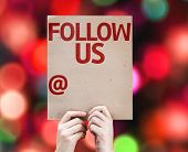 Follow Us and a Copy Space to Put Your Profile card with colorful background with defocused lights