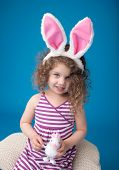 Happy Laughing Smiling Child With Easter Bunny