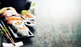 image of soy sauce  - Closeup of fresh sushi  on rustic wooden table - JPG