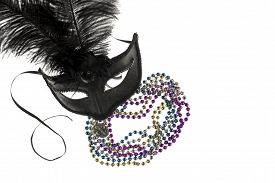 picture of debauchery  - Shiny gold purple blue and silver beads and Mardi Gras mask with feathers and fleur d - JPG