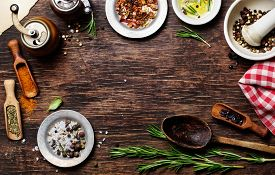 picture of flavor  - Spices for use as cooking ingredients on a wooden background with copyspace - JPG