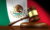 pic of law order  - Law and justice of Mexico concept with a 3d rendering of a gavel on a wooden desktop and the Mexican flag on background - JPG