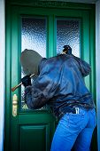 stock photo of judiciary  - A Eibrecher at the door of a house - JPG