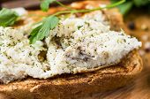 image of scrambled eggs  - Toast with scrambled eggs on a wooden board with parsley - JPG