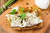 picture of scrambled eggs  - Toast with scrambled eggs on a wooden board with parsley - JPG