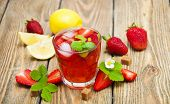 foto of cold drink  - Cold strawberry drink with fresh strawberries and lemon on wooden background  - JPG