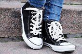 picture of street-walker  - Female feet in gumshoes on  stone stairs - JPG