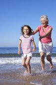 picture of chase  - Grandmother Chasing Granddaughter Along Beach - JPG