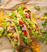 stock photo of tacos  - Tasty taco with greens on paper close up - JPG
